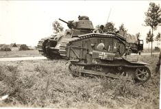 """Char B1 a French heavy tank manufactured before World War II. with a 75 mm howitzer in the hull; later a 47 mm gun in the turret was added, to allow it to function also as a Char de Bataille, a """"battle tank"""""""