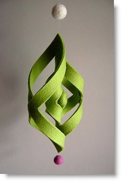 A felt square that is cut so simple then glued/sewn in place, add fishing line, beads or whatever you want & you have a simple, cheap, new christmas craft. So simple you could do this with you kids, make a bunch of them & have only these on the tree.