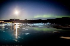 It seems like the coronal hole fast stream of solar wind arrived early. Last night (18 September), the Aurora appeared while sailing from Disko Island back to Ilulissat (Greenland). Hard to shoot with the rocking boat, but what a beautiful show above the UNESCO site icebergs in the background! Taken by Rayann Elzein on September 18, 2016 @ Ilulissat, Greenland