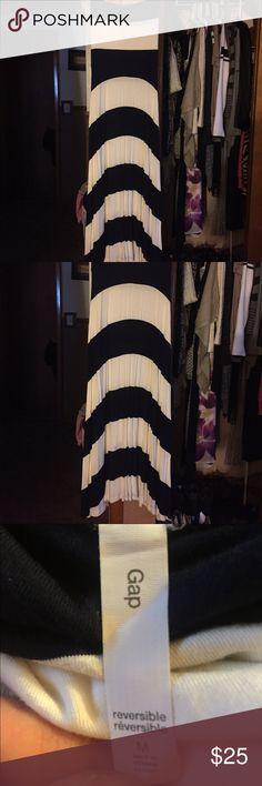 Gap cream and Navy reversible dress ! Gap cream and Navy reversible dress when I say reversible I mean can be worn as a maxi dress or folded down as a long skirt ! Size medium very stretchy material would fit a large to! Goes great with the cream lucky brand wedges I have listed! Only worn once EUC! Please feel free to ask any questions! I personally guarantee that all of my items are in excellent condition and are as described! Thanks for checking out my closet Happy Poshing 💞 GAP Dresses…