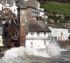 The famous clock tower of the coastal village of Kingsand, Cornwall bears the brunt of win...