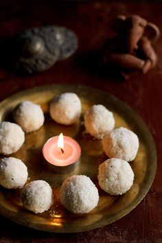 coconut ladoo recipe for ganesh chaturthi festival – melt in the mouth ladoos made with desiccated coconut. step by step recipe.