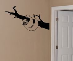 """Cuteness overload!! How adorable is this Sloth wall decal? He comes hanging on a branch with a super cute grin. Dimensions: This sloth sticker measures 42"""" wide and 23"""" tall. Looking for a different s"""