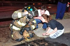 A firefighter (hero) after he rescued a dog from a burning house.