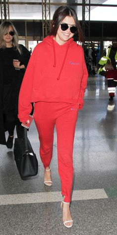 Selena Gomez rocked sweats and heels while zipping through the airport.