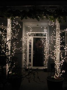 My front porch at Christmas 2012.  Lighted branches....more pictures to come as I do more decorating for the Christmas Holiday.  I cut branches from my backyard and placed in pots on the porch.
