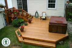 This lovely quaint bi level deck was constructed with eon decking and cedar trim. A small landing takes you from the back door to the main deck area were the spa is located. Terraced wrap around steps enclose the perimeter of the deck. Patio Deck Designs, Patio Design, Patio Ideas, Porch Ideas, 2 Tier Deck Ideas, Yard Ideas, Landscaping Ideas, Garden Design, Small Garden Pergola