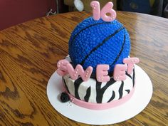 Sweet 16 cake I made for my Niece.  That's a basketball in her school colors.