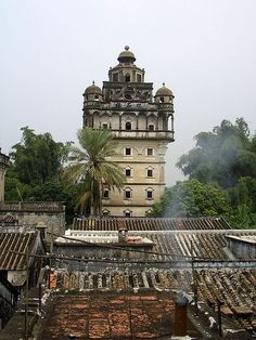"""KAIPING DIAOLOU, China: are fortified multi-storey towers, generally made of reinforced concrete. Kaiping & its neighbouring counties are collectively known as the """"Four Counties"""" from which many Chinese labourers to North America, Australia, & Southeast Asia emigrated to escape the banditry & civil war in the region. The first towers were built during the early Qing Dynasty, reaching a peak in the 1920s-1930s, when there were more than 3000 of these structures."""