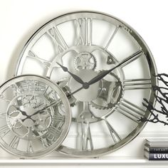 Wow!  What a cool look for a wall clock!          Zodax IN-458 Regatta Polished Nickel Wall Clock - Decor Universe