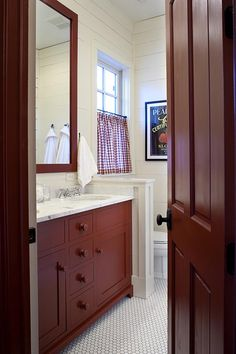 Love this bathroom with cabinets and mirror painted in @Benjamin Moore Country Redwood.
