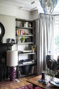 Bespoke designed industrial alcove shelving - reclaimed scaffold board and steel.