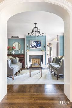 Blue-Green Living Room Wrapped in Silk Wallcoverings