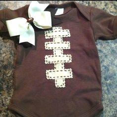 Football onesie for a baby girl.