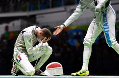 TOPSHOT - France's Jeremy Cadot reacts to losing against Italy's Andrea Cassara (R) in their mens individual foil qualifying bout as part of the fencing event of the Rio 2016 Olympic Games, on August 7, 2016, at the Carioca Arena 3, in Rio de Janeiro. / AFP / Fabrice COFFRINI (Photo credit should read FABRICE COFFRINI/AFP/Getty Images)