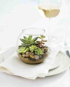 "These mini terrariums make chic table decor when grouped en masse -- and they double as favors, too! Just place sand and rocks in the bottom of a fishbowl votive holder. Carefully set small succulents among the rocks -- securing them, if necessary, with toothpicks -- and quench their thirst with a dropper. ""Bubbleball"" 4 3/4"" vase, Save-On-Crafts.com."