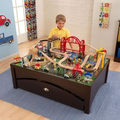 The Kidkraft Metropolis Table and Train Set lets kids take control of an entire city. The train set is loaded with fun features and interactive pieces and the high-quality wooden table takes playtime