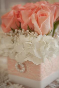 #peach #coral #centerpiece #rose #pearls, check us out at www.lepapillonevents.com
