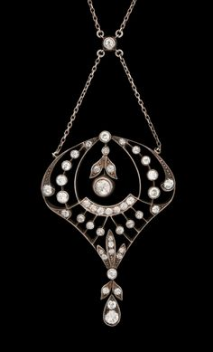 A old cut diamond pendant.  14k gold and silver. Edwardian or Edwardian style.
