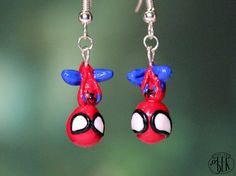 Spiderman inspired french hook earrings by thePetiteGeek on Etsy $17.00  Visit thePetiteGeek's shop on Etsy and send her a message to order a pair! She has other DC/Marvel characters