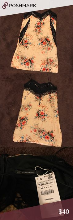 Zara Floral Slip Dress Zara floral slip dress with lace detailing and button closure on the back. Never before worn, super cute for fall with OTK boots! size: XS color: multi Zara Dresses Mini