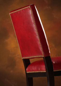 The outback of the Manchester Dining Chair uses nailhead trim to highlight the raised back and as a nice contrast to the red leather and dark finish of the legs. Leather Dining Chairs, Parsons Chairs, Wing Chair, Nailhead Trim, Highlight, Manchester, Red Leather, Contrast, Dining Room