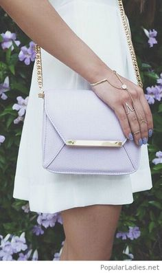 white-dress-with-light-purple-bag