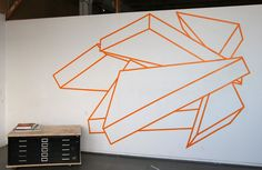 "Rhetoric Serves to Unify the Group, tape, approx. 8'6""x14', 2010."
