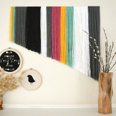 DIY Yarn Wall Art Simple, Inexpensive and Fun to make! This yarn wall art can be made in no time at all, in any colors!