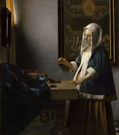 """cimmerianweathers: """"Woman Holding a Balance, by Johannes Vermeer, 1662-63. Oil on canvas. """""""