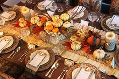 Lovely Thanksgiving Table Runner made of pumpkins, gourds and candles