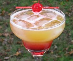 Dingo    (1.5 oz. Light Rum  1 oz. Southern Comfort  1 oz. Amaretto  1 oz. Sweet  Sour mix  2 oz. Orange Juice  .5 oz Grenadine  Cherry for garnish)