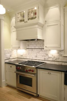 Traditional Kitchen Design with Leaded Glass Cabinets traditional kitchen Marble Tile Backsplash, Soapstone Countertops, Countertop Oven, Subway Tiles, Granite, Kitchen Must Haves, Kitchen Ideas, Kitchen Design, Leaded Glass Cabinets