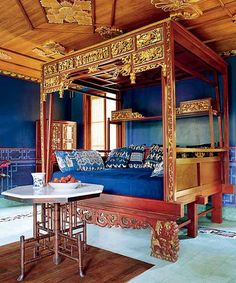 Chinese Indonesian Wedding Bed with Sumba Ikat pillows.   Bali blue!