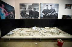 His diorama of Tiananmen Square, constructed out of 350 pounds of rotting pork, was destroyed by the police this week | The artist, Guo Jian, 52, has been in police custody since June 1, one day after photos of his latest work, 'THE SQUARE', appeared in The Financial Times along with his reminiscences of the army onslaught that killed hundreds of people during the pro-democracy demonstrations in Tiananmen Square in 1989.