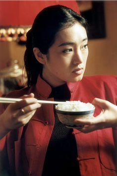 Gong Li // photo by Willy Rizzo