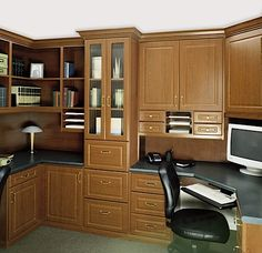 Prestige executive office in a Wild Cherry finish Melamine featuring two work stations, Deco drawers and doors with glass inserts, open corner shelves, office accessory inserts and adjustable keyboard tray.