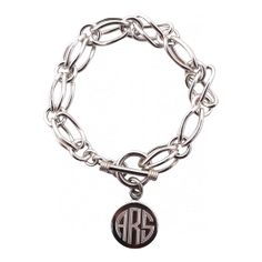 A stunning statement piece, this sterling silver double link charm bracelet is the perfect update on a classic. Base price includes the monogram charm and add our sterling silver charms to personalize yours until your little heart is content! The details:  This heirloom quality piece measures 7 inches in length and secures with a loop and toggle with a touch of equestrian inspiration. We can not accept returns on custom items, however each piece is guaranteed from flaws in workmanship for…