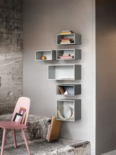 Unusual storage solution with mini stacked storage boxes from Muuto. Stunning soft pink Nerd chair. Danish furniture design.
