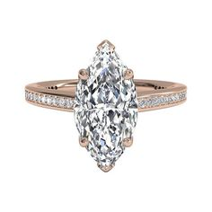 An 18kt rose gold marquise-cut engagement ring, adorned with micropave diamonds. Available in 18kt Rose Gold (0.20 CTW) for a Marquise Center Stone