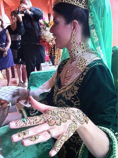 Morocco | Brides often wear henna on their hands, and may change outfits multiple times.