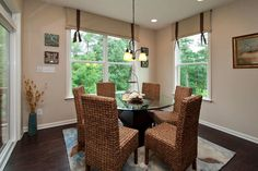 Kitchen cafe with dark wood floors and a lot of natural light!