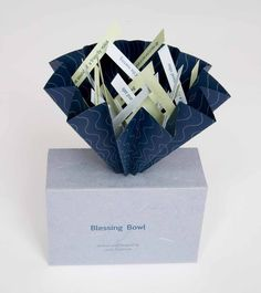 Linda Johnson, United States  The Blessing Bowl  Accordion fold flag book structure with magnetic closure, letterpress printed from photo polymer plates on various Strathmore and mould made papers; housed in a handmade box.  18 x 18 x 10 cm  2007