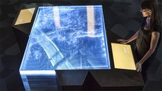 lucite layered map table + connected building with multiple experiences