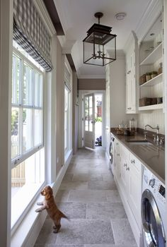 A glamorous laundry room connects the kitchen to the outdoors.