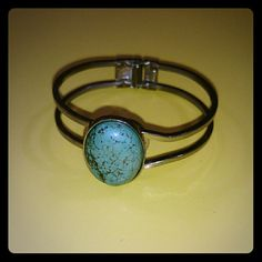 """Vintage Turquoise Bracelet! The pictures do not do this bracelet justice! 100% real turquoise and silver tone hardware with adjustable band. Perfect condition for a vintage piece! My wrist is 6 1/2"""" and this fits perfectly!  I am unsure if this is true sterling silver or stainless steel!   It is optional to have me polish this piece before shipping!  *same or next day shipping!* *this item comes with a free gift!* Jewelry Bracelets"""