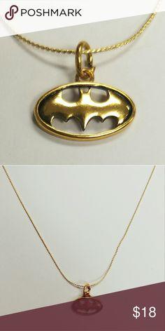 Gold DC Comics Batman Symbol Necklace Licensed DC Comics Batman Symbol Pendant On an 18K Gold Plated Necklace. DC Jewelry Necklaces