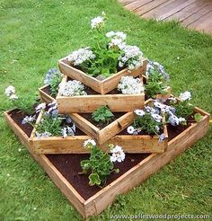 Who needs to do any building? Take some of the pallets that are constructed best, and make a few changes, such as removing the slats from one side and closing the four ends with a board. Use it as a single box planter, using landscaping fabric to line it on the bottom.