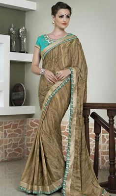 Look stunningly beautiful dressed in this beige color crepe silk sari. This appealing saree is showing some extraordinary embroidery done with lace and resham work.  #fancysarees #borderworksari #beigeshadesofsaris