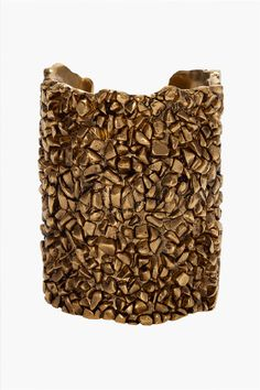 Yves Saint Laurent Gold Cuff almost looks as tho it is made from Coffee beans! It is Fantasticly Gorgeous!